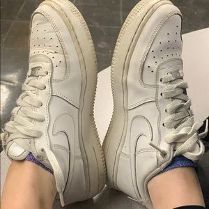 All white air forces. Worn but good condition
